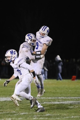Triton players jump with joy after denying Xavier's two-point conversion in the final moments of Friday night's playoff win.