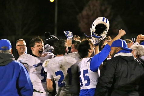 Triton players celebrate after the win over, previously undefeated, Xavier.