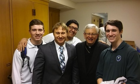 Alter servers, Mr.Kriegl and Bishop David Ricken after the mass for Catholic Schools Week.
