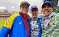 Cross country coaches add the Red Sox-Rays ALDS to their Boston Marathon trip.  From left: Cassidy McGowan, John Gard, Kim Lasecki