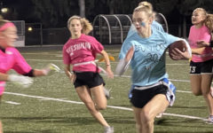 Hope Barington evades freshmen defenders on the way to a 2021 Powderpuff Championship